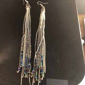 Free people long silver beaded earrings.